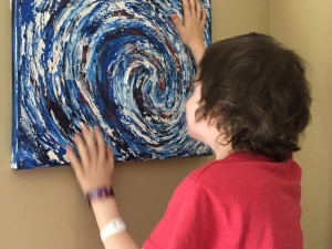 cancer survivor playing with Anne's art